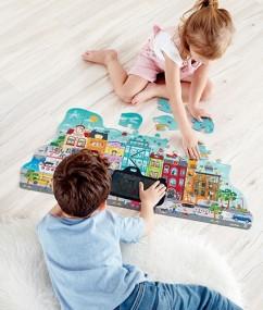puzzel - kunsstof - animatie stadspuzzel - animated city puzzle - speelgoed - houten speelgoed - hape - dn houten tol - de mouthoeve - boekel - winkel - E1629 - kleuter